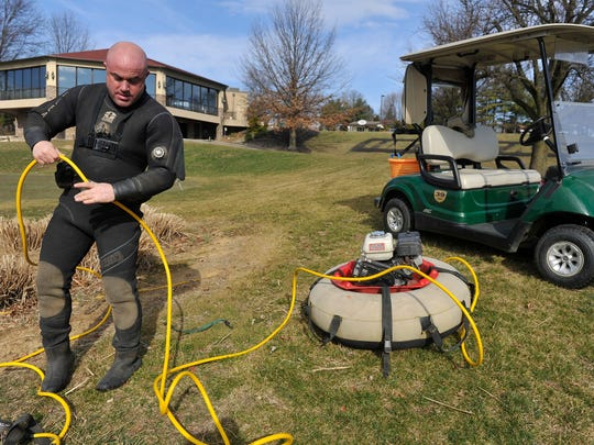 "Steve Goodley untangles the hose to his airline before diving into a pond at Heritage Hills Golf Resort in February. His goal is finding balls, which he sells to a national buyer. But he also finds plenty of clubs, and used to keep every one, piling up as many as 250 in his garage. But he's given most of them away to friends and donated others to youth programs. ""I'm left-handed, and I never find a good left-handed club,"" Goodley said, joking."