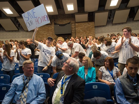 Career Magnet School supporters stand and applaud as someone speaks to let the CASD board know why they don't want the school to be closed or changed. The meeting was held at CAMS South on Tuesday, April 18, 2017.