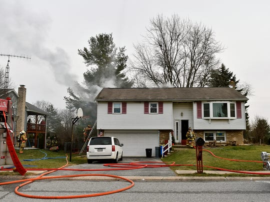 Firefighters work the scene of a house fire Friday in Jackson Township.