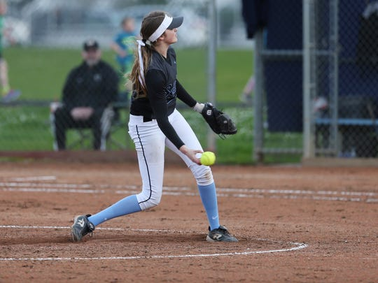 South Salem's Maygen McGrath pitches as the Saxons