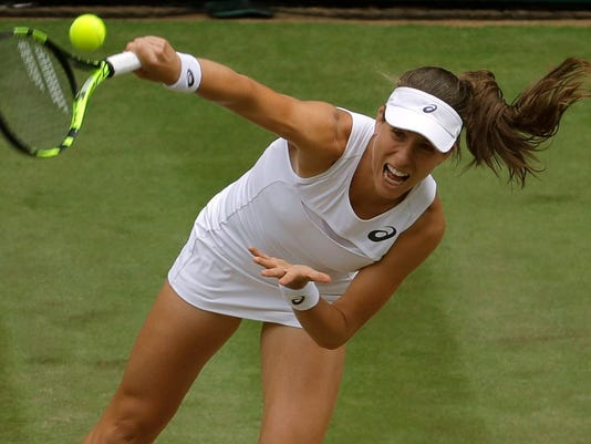 Britain's Johanna Konta serves to Venus Williams of the United States during their Women's Singles semifinal match on day nine at the Wimbledon Tennis Championships in London Thursday, July 13, 2017. (AP Photo/Alastair Grant)