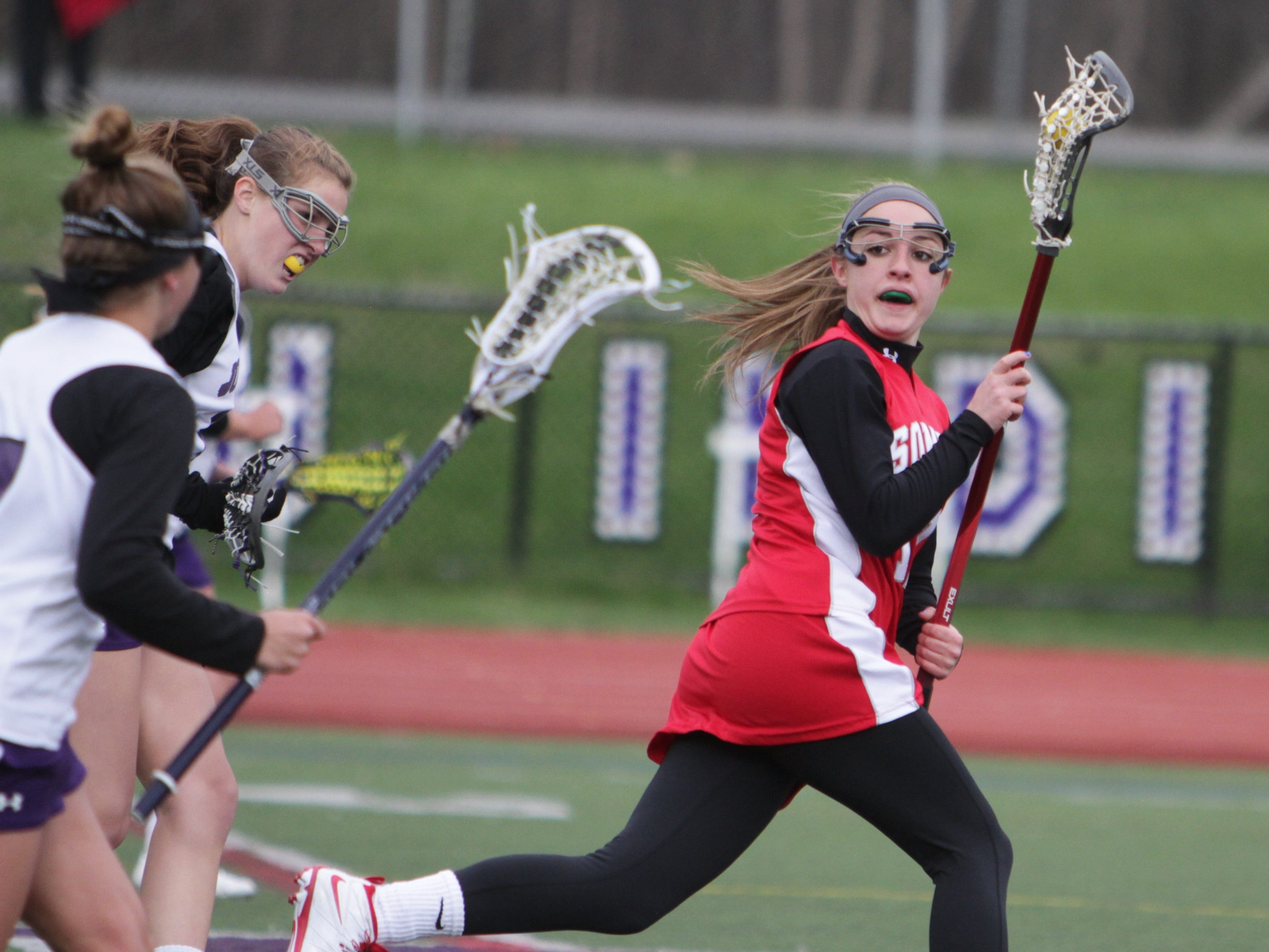 Somers' Nicole DeMase runs with the ball up the midfield during Friday's game at John Jay. She finished with seven goals, and Somers won 16-14.