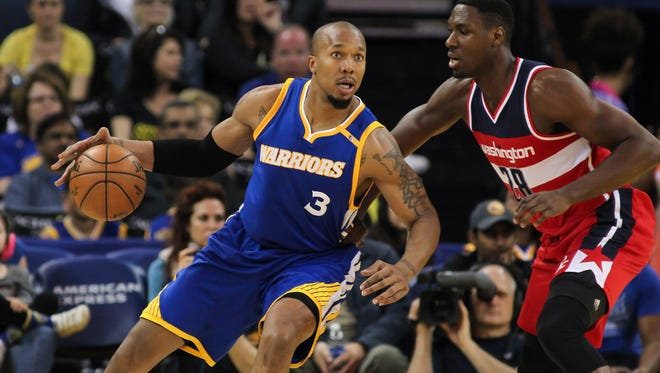 Golden State Warriors forward David West (3) dribbles the ball against Washington Wizards center Ian Mahinmi (28) during the second quarter at Oracle Arena on April 2.