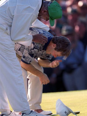 Ben Crenshaw is overcome by emotion and consoled by his caddie, Carl Jackson, at the 1995 Masters after defeating Davis Love III by one stroke for his second Masters win.