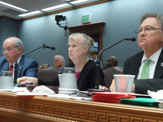 Reps. Terry Brown (left) and Gene Reynolds (right) are joined by New Iberia chemist Wilma Subra as they talk about House Bill 11 to ban open burning of munitions and explosives April 27 during a House committee hearing. The bill won committee approval but was withdrawn Monday before being heard by the full House.