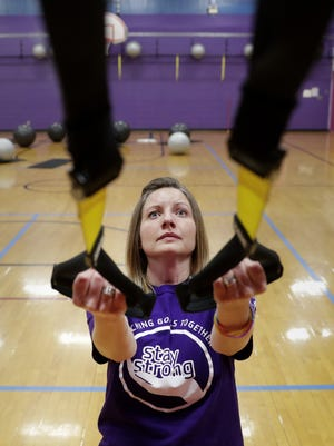 April Hershman, a cancer survivor, works out at the Appleton YMCA in preparation for the Sole Burner 5K run/walk on Saturday.
