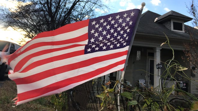 An American flag waves near the location where President Obama was speaking at Casa Azafran in 2014. Surveys and tests repeatedly show that Americans' knowledge of civics is pathetic.