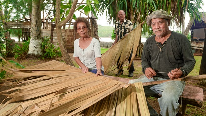 From left, crafter Rosita San Nicolas, site manager Carlos Paulino and maintenance worker Paul Naputi  pose for a photo at the Gef Pa'go Chamorro Cultural Village in Inarajan on Thursday, Jan. 7.
