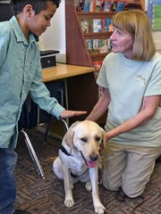 Volunteers with The Seeing Eye organization visited