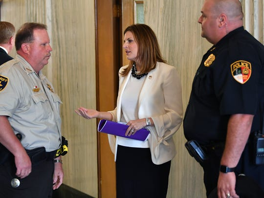 U.S. Attorney Erin Nealy Cox talks with Wichita County Sheriff David Duke, left, and Vernon Police Chief Randy Agan following a press conference Thursday at the Federal Courthouse.
