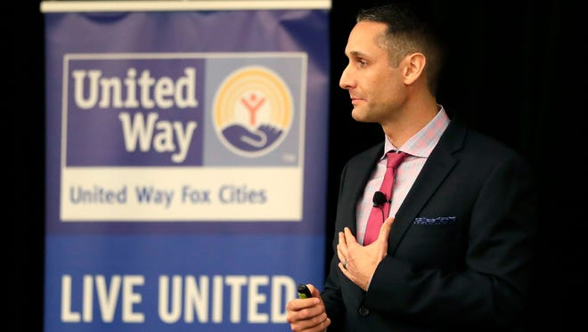 Steve Jones, head football coach at Kimberly High School, gives the keynote speech during the United Way Fox Cities 2017 Annual Report to the Community Monday at the Radisson Paper Valley Hotel in Appleton.