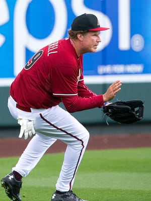 Actor Will Ferrell plays left field for the Diamondbacks during their spring training game against the Cincinnati Reds at Salt River Fields at Talking Stick on Thursday, March 12, 2015.