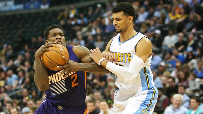 Phoenix Suns guard Eric Bledsoe (2) drives to the basket against Denver Nuggets guard Jamal Murray (27) during the first half at Pepsi Center, Nov. 16, 2016.