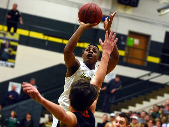 Gallatin junior Zyun Mason elevates for a jump shot