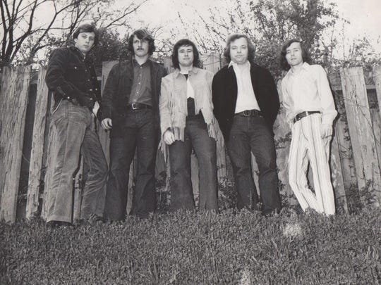 Not, it's not a vintage album cover, it's a portrait of some of the original FM100 deejays: Greg Hamilton (from left), David Day, Jon Scott, Mike Powell and Ron Michaels.