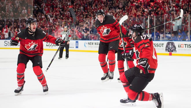 Canada forward Tyler Steenbergen (17) celebrates his winning goal against Sweden during third-period gold medal game IIHF world junior championship hockey game action in Buffalo, N.Y.,  Friday, Jan. 5, 2018. (Frank Gunn/The Canadian Press via AP)