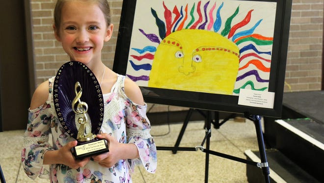 """Emersyn Wells, a Rose Hill Elementary kindergartner, won the Prelude Award for her piece, """"Happy Colors,"""" during a reception for the winners of the 21st Color of Music Contest held April 7 at the Carl Perkins Civic Center in Jackson."""