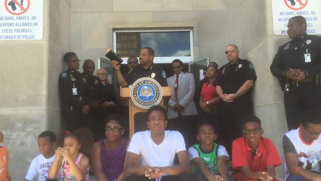 Jackson Police Chief Lee Vance speaks to the gathering at the prayer service at JPD headquarters Friday.