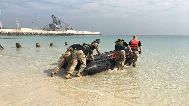 Soldiers from the 2nd Engineer Battalion pushed their Zodiac boat into the water during the Castle Crucible event at the Kuwait Naval Base in January.