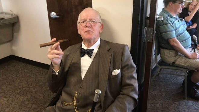 Sir Winston Churchill, portrayed by Larry Bounds of Greenville, talks with history fans at the Military History Center of the Carolinas.