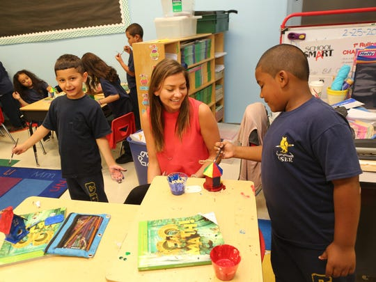 Students paint bird houses at the Charter School of Educational Excellence in Yonkers.