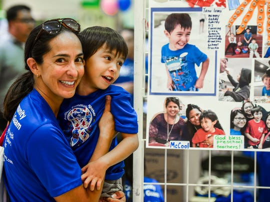 Four-year-old Tano Manibusan is photographed with his mother, Tina Manibusan,  during the 11th annual Autism Awareness Fair at the Agana Shopping Center on Saturday, April 14, 2018.