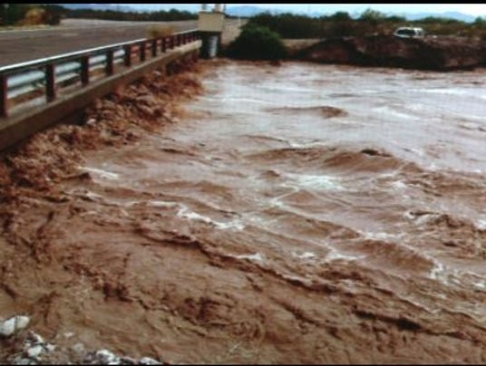 Runoff water in Laveen where a floodplain canal channels water.
