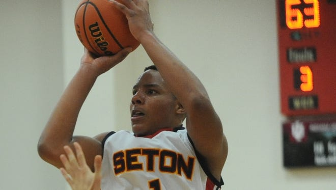 Seton Catholic's Desmond Bane takes a shot during Friday's season-opening victory over National Trail.