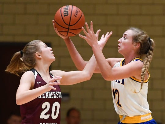 Henderson's Kaytlan Kemp (20) goes for a steal against Castle's Josie Freeman (42) as the Castle Knights play the Henderson County Lady Colonels at Castle Tuesday, December 5, 2017.