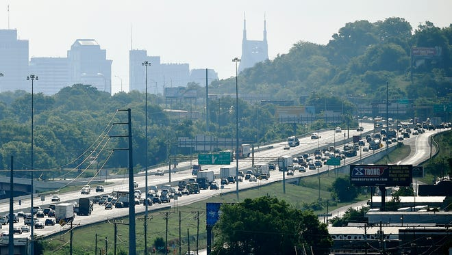 Morning traffic makes its way eastbound on Interstate 40 near the Interstate 440 interchange Tuesday, June 21, 2016, in Nashville.