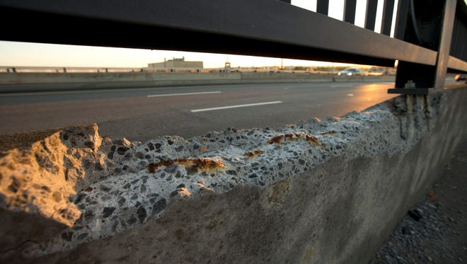 Cracked concrete exposes parts of reinforcement bars on the Frederick Douglass Memorial Bridge which spans the Anacostia River in Washington on Sept. 4, 2013.
