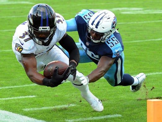 Baltimore Ravens running back Javorius Allen is knocked