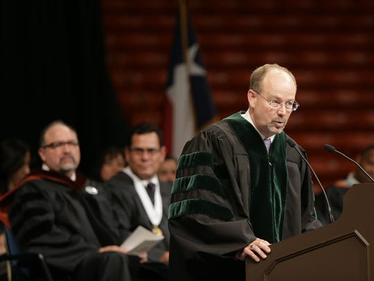 Burges High School Principal Randall Woods speaks at a graduation ceremony in the Don Haskins Center.