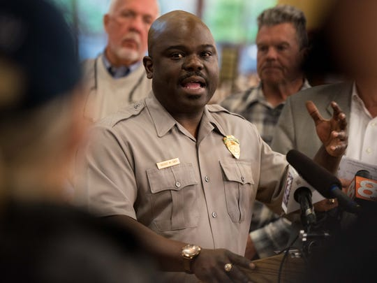 Cassius Cash, superintendent of the Great Smoky Mountains National Park, speaks during a press conference in Gatlinburg, Tenn., Wednesday, Nov. 30, 2016.