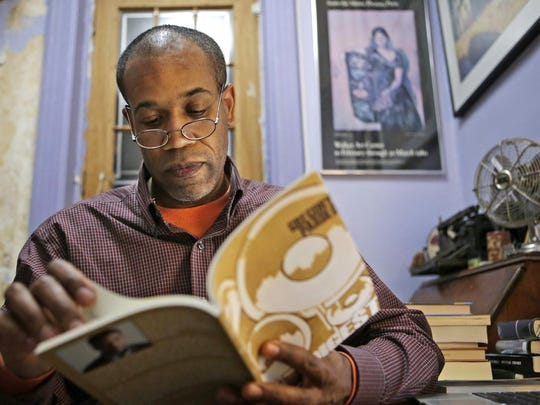 Gregory Pardlo, winner of the 2015 Pulitzer Prize for poetry, thumbs through 'Digest,' his book of poems that won the award, at his home in the Brooklyn shortly after finding out he won.