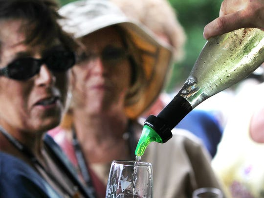 Samples of wines from French Lick Winery are poured at the 14th annual Vintage Indiana Wine & Food Festival last June.