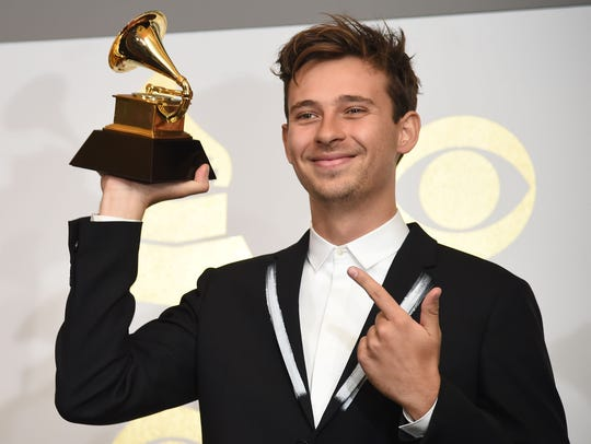 Flume poses in the press room with his Grammy for Best
