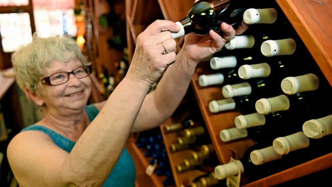 Sue Hadley stocks shelves with wine Friday, June 30, 2016 at Tuscarora Winery, Chambersburg. A new law signed by Gov. Wolf allows limited sales of wine at grocery stores and beer at convenience stores in Pennsylvania.