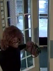 Police are trying to identify this alleged robbery who ran out of a bank with money on Tuesday morning.