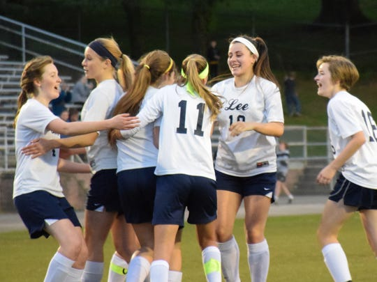 Teammates surround Robert E. Lee's Leah Davis, third from left, after she scored  a first-half goal during the Lee Ladies' Valley District girls soccer game against Waynesboro on Tuesday, May 9, 2017, at Winston-Wine Memorial Stadium in Staunton, Va. The game ended in a 2-2 tie.