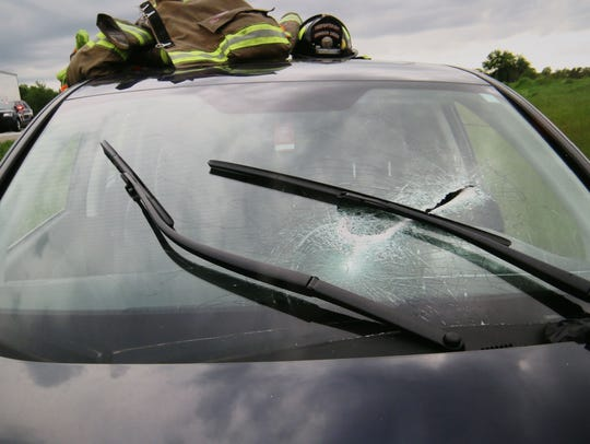 A photo taken by authorities shows the hole in Jay Tichelaar's windshield, which was pierced by a piece of brake drum that fell off a truck on I-94 in Jefferson County, instantly killing the Brookfield man on May 22, 2017.