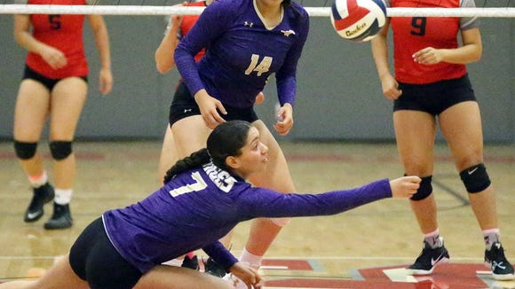 Savannah Marenco, 7, of Burges reaches to keep the ball alive during a volley against Jefferson. The Mustangs prevailed over the Foxes in three sets.