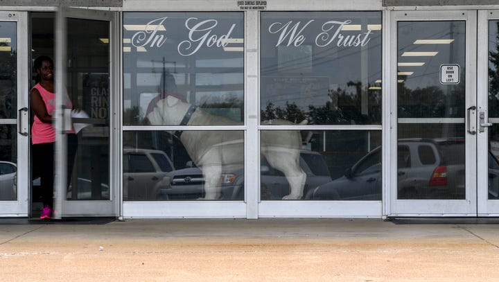 """The """"In God We Trust"""" phrase can be seen in the windows"""