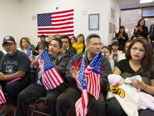 Oscar Cortez (from left), Enrique Bravo, Leonel Flores and Cristina Gutierrez listen to speakers at Nevada Headquarters of Mi Familia Vota before heading to Las Vegas for President Obama's rally at Del Sol High School in Las Vegas on Friday, Nov. 21, 2014.