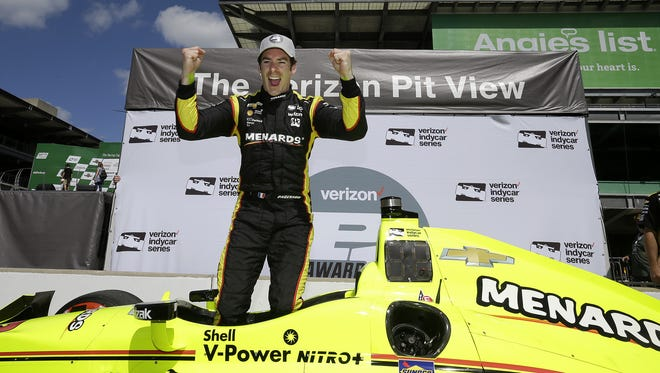 IndyCar driver Simon Pagenaud celebrates winning the pole position for the Angie's List Grand Prix of Indianapolis Friday, May 13, 2016, morning at the Indianapolis Motor Speedway.