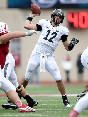 Purdue Boilermakers quarterback Austin Appleby (12) drops back to pass on the Hoosier defense.Indiana University defeated Purdue University 23-16 in the Old Oaken Bucket game Satuday, November 29, 2014, at Memorial Stadium in Bloomington IN.