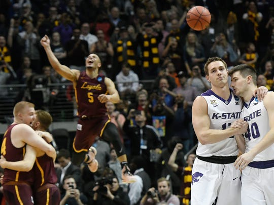 Loyola-Chicago players celebrate as Kansas State leaves the court in the regional final game on Saturday.