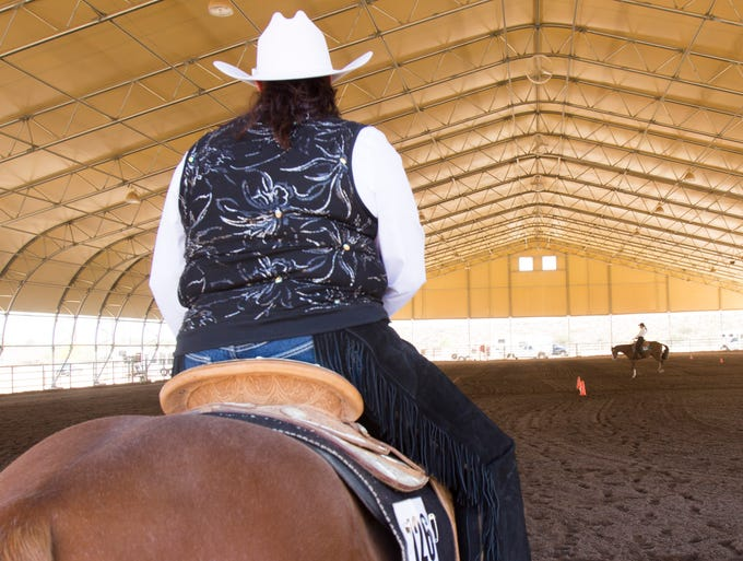 Carla Cline sits on her  horse waiting for her opportunity to compete in the Arizona Painted Horse Club Spring Fling at WestWorld in Scottsdale on April 12, 2014.