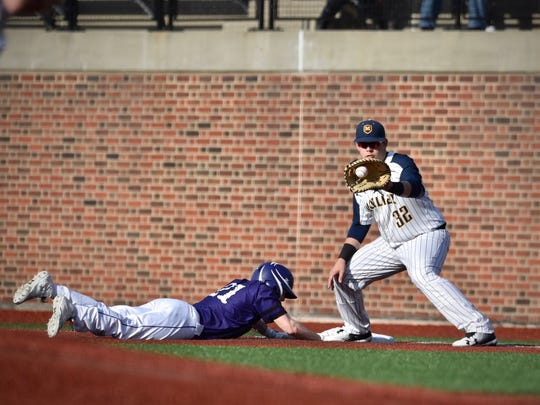 Moeller's Mo Schaffer fields a pick-off attempt  on
