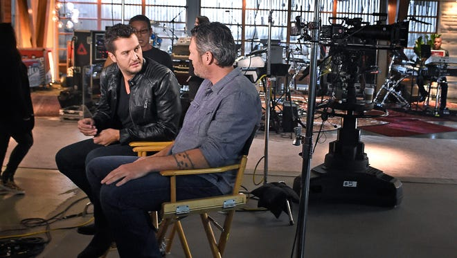 "Luke Bryan will mentor Blake Shelton's team on season 12 of ""The Voice."" The singers chat on set during filming of the show's battle rounds Jan. 16, 2017, in Los Angeles."